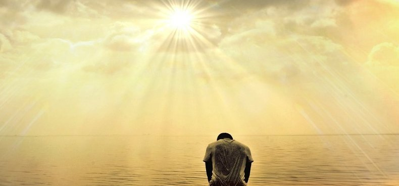 man praying in view of the holiness of God